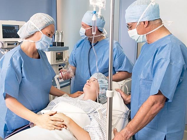 Patientin mit OP-Team